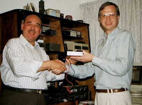 Chris, G3WOS presenting Ezzat, SU1ER with the 100 watt amplifier.
